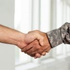 a civilian and a Veteran hand shaking