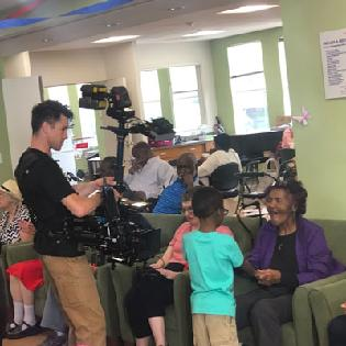 M&B Bank films a commercial in the Harry and Jeanette Weinberg Inter-Generational Center.