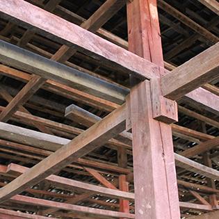 Posts inside old tobacco barn