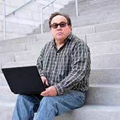 autistic man with digital media