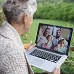 Senior woman videochatting with family