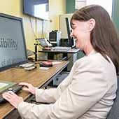 woman using computer with accessibility tools