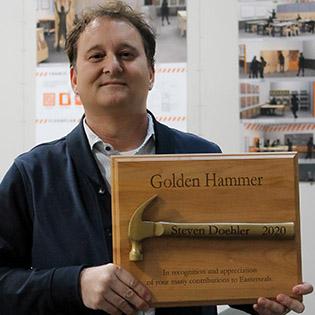 Steve Doehler holding Golden Hammer award