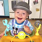 Smiling baby with Down syndrome