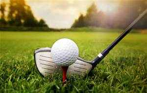 photo of golf club and golf ball on grass