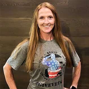 Fitness instructor Trena Perrine models the GiveVets22 shirt.