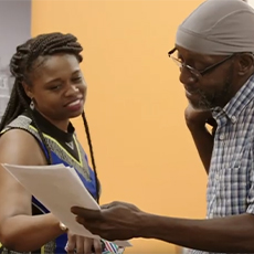 Anthony, a participant in Prosperity for All, consults with program manager Brandi Lewis.