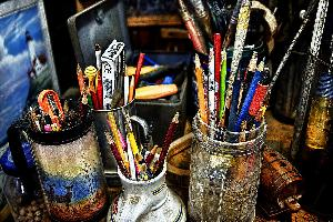 photo of paintbrushes in jars