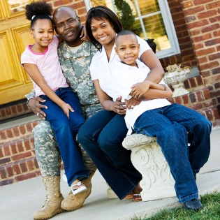 Veteran and his family outside their home