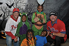 Kids dressed for halloween with to men wearing Phillies Jerseys