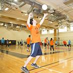 Man serving volleyball
