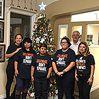 Easterseals Participants and Century 21 Associates Decorate Century 21 Real Estate Christmas Tree