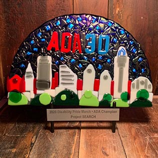 Glass ADA 30 award created by artists of InsideOut Studio