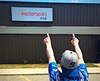 Rear view of man pointing at Easterseals RISE sign
