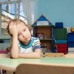 sad child in kindergarten