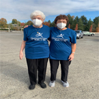 Ardyce and Linda in masks and Walk With Me shirts