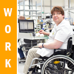 Work. Photo of a man who uses a wheelchair sitting at a desk working on a laptop.