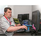 man using computer with accessibility tools