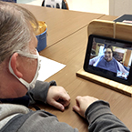 Participants using Zoom to video chat