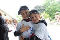Two young participants wearing Walk With Me T-shirts